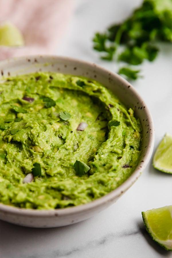 Guacamole prepared in bowl on counter