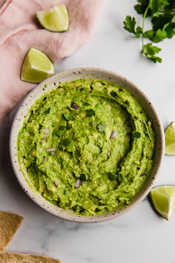 Top view of prepared guacamole in bowl on counter