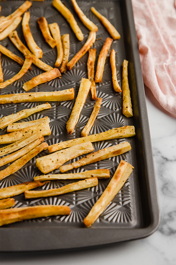 parsnip fries on baking sheet