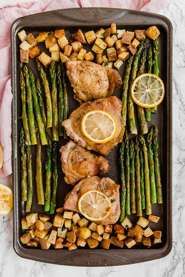 sheet pan lemon chicken & asparagus in pan