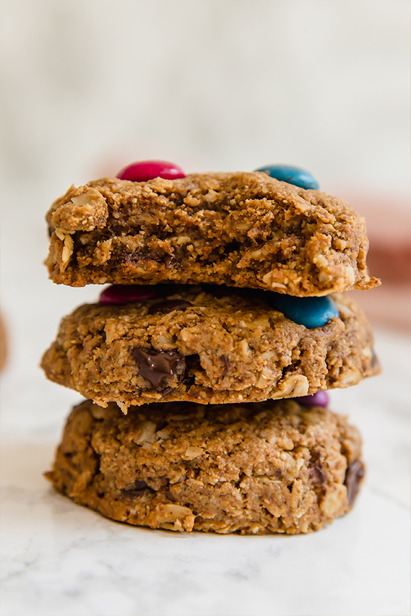 Three monster cookies stacked on top of eachother