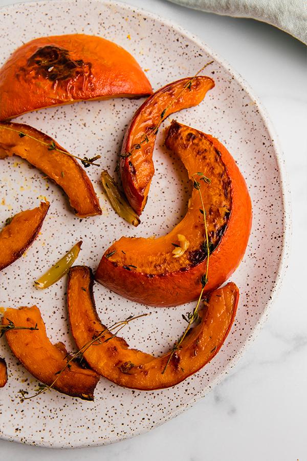 roasted red kuri squash slices on plate