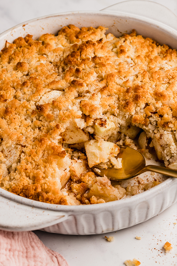 apple crisp in baking dish with spoon