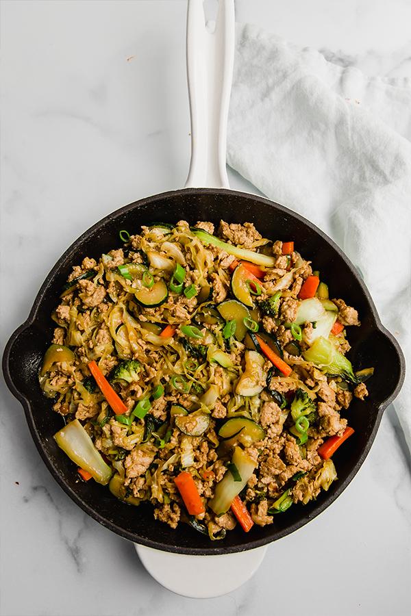 ground turkey and vegetable teriyaki stir fry in cast iron skillet