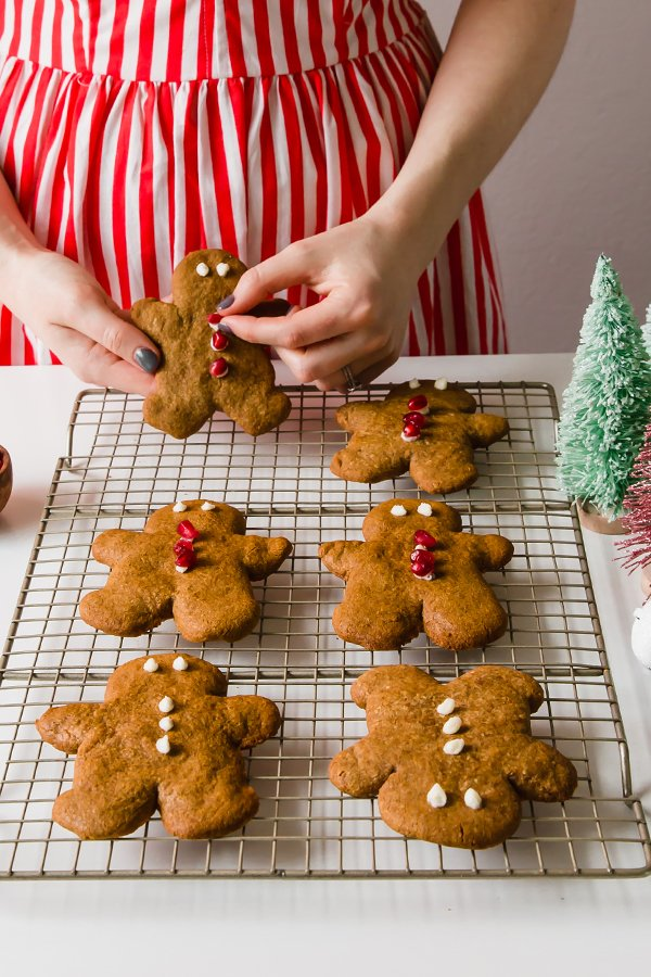 woman in red and white dress with gingerbread cookies