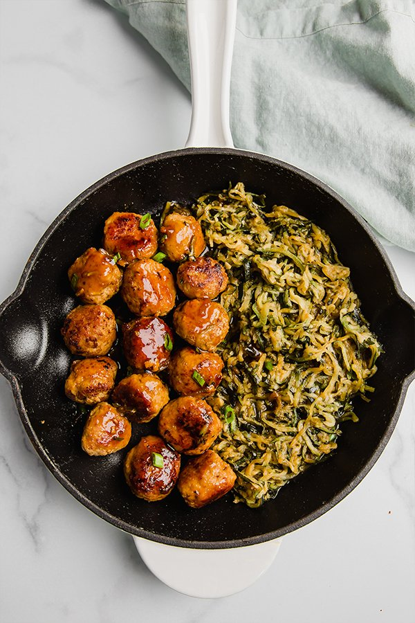 teriyaki turkey meatballs in skillet with zucchini noodles