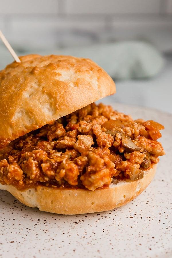 turkey sloppy joe in sandwich bun with toothpick