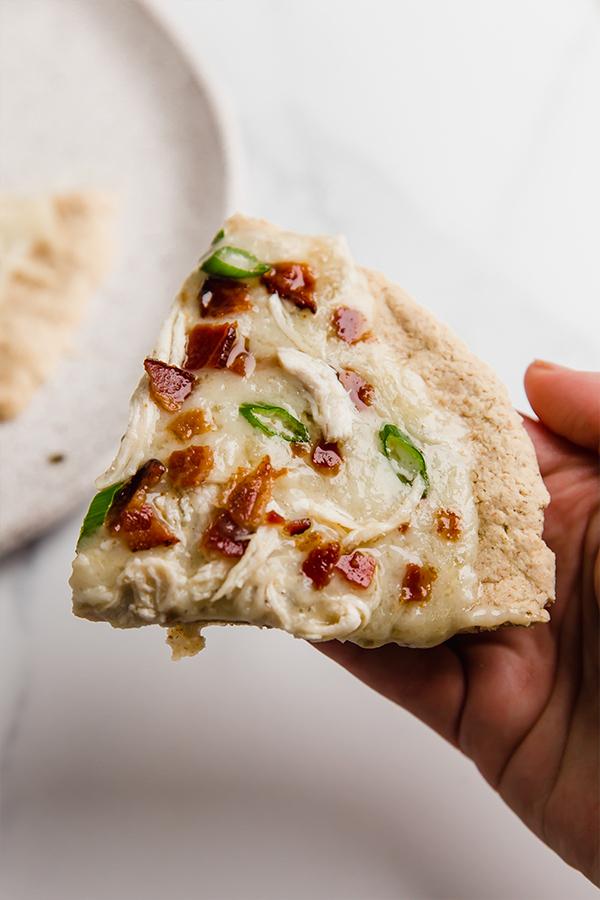 pizza slice in hands