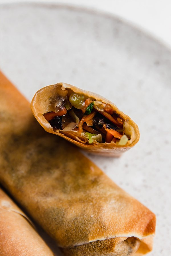 air fryer egg rolls open with filling showing