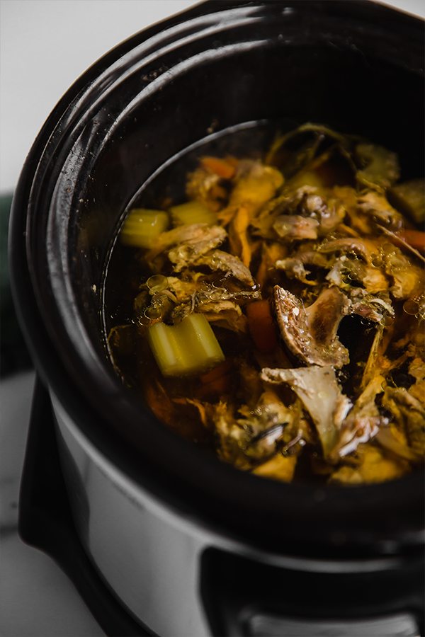 broth and carcass in slow cooker