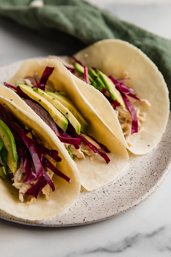 cilantro lime chicken tacos on plate