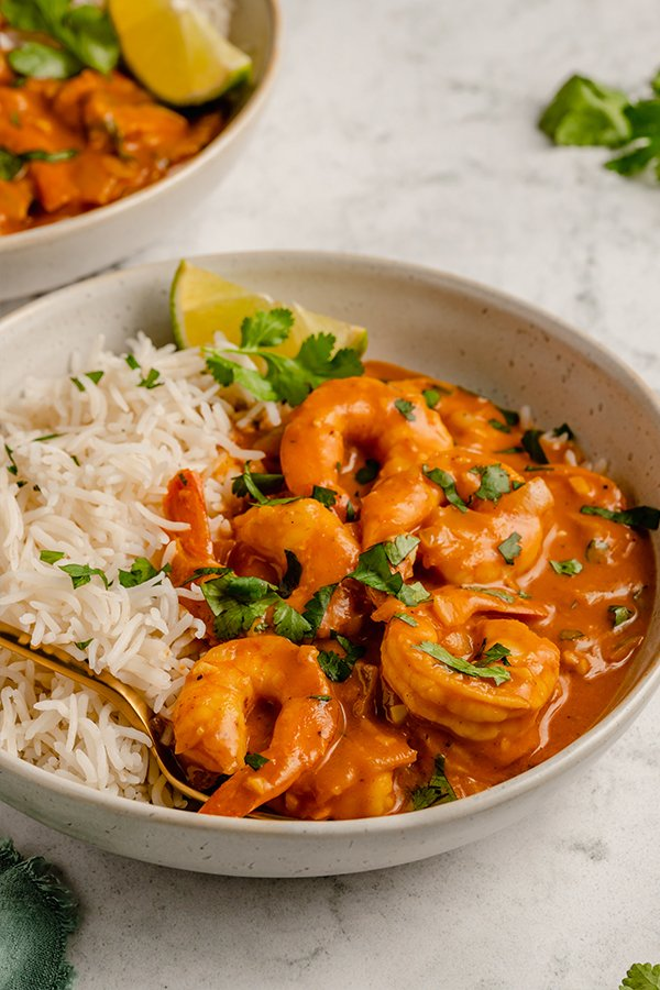 shrimp curry in a bowl with rice