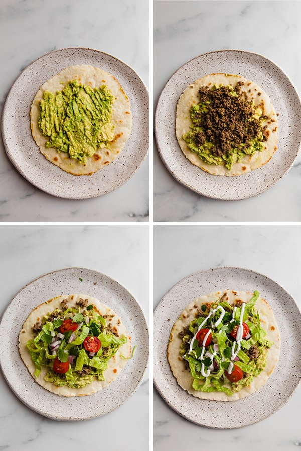 Grain free tostadas being assembled with avocado, beef, then toppings