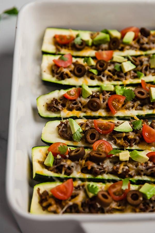 Stuffed zucchinis in baking dish