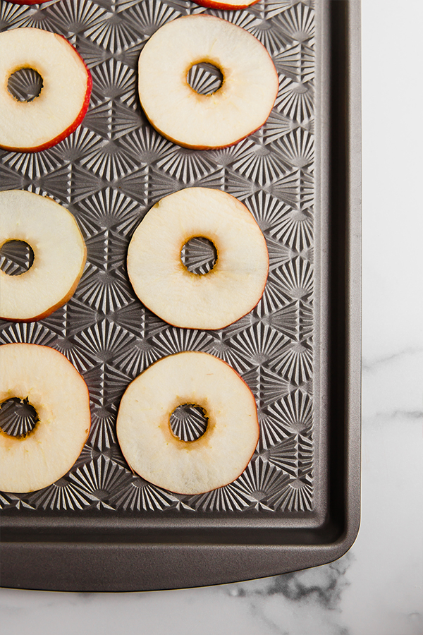 Apple slices on sheet pan ready to put on toppings