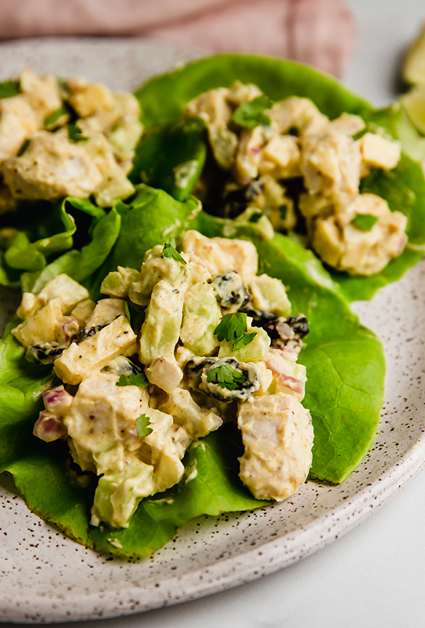 Yogurt curry chicken salad served on butter lettuce on a plate