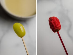 Grape with toothpick inserted ready to dip