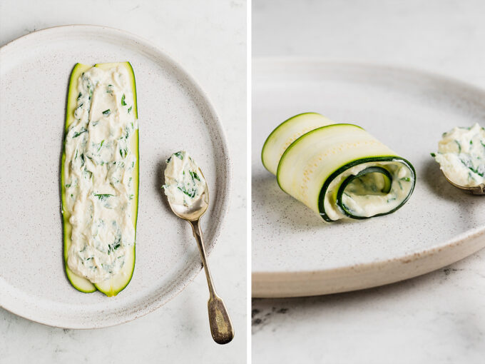 Slices of zucchini with ricotta cheese spread on and rolled up
