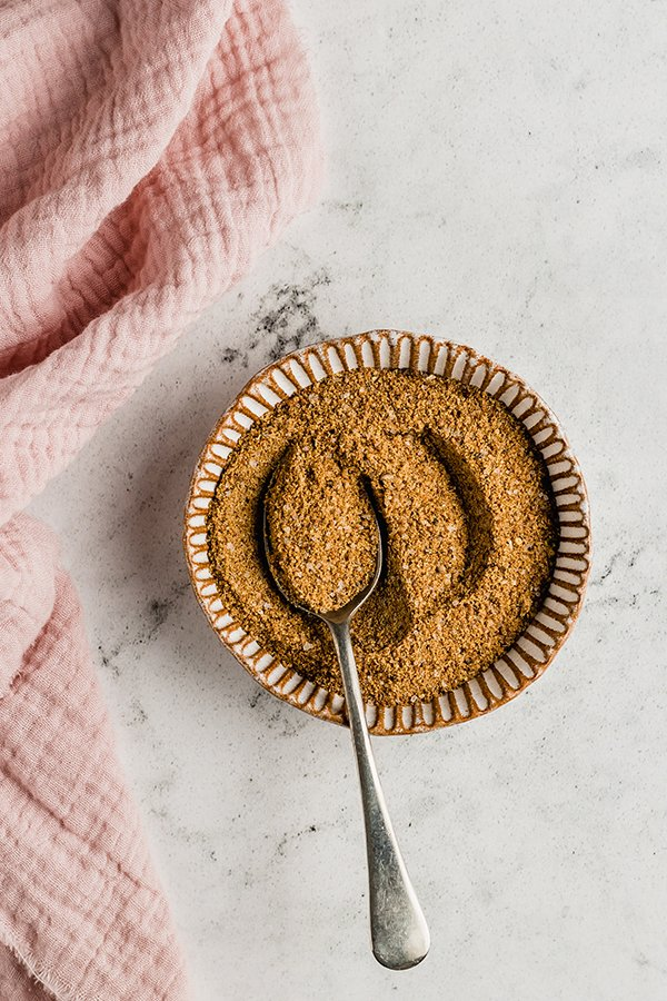Spice rub mixed in a bowl with a spoon