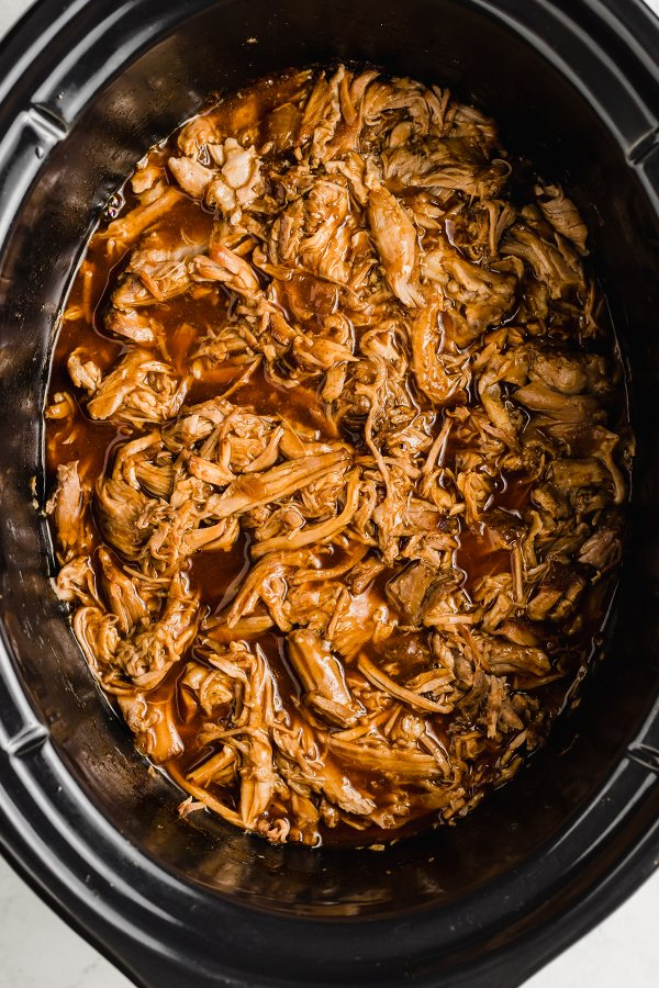 pulled pork in insert of slow cooker