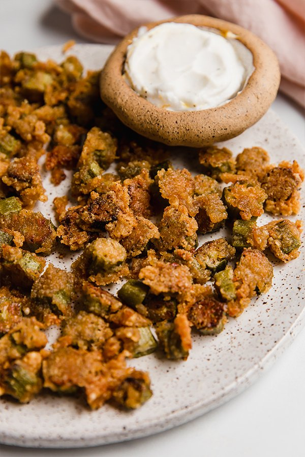 Crispy okra on plate with dipping sauce