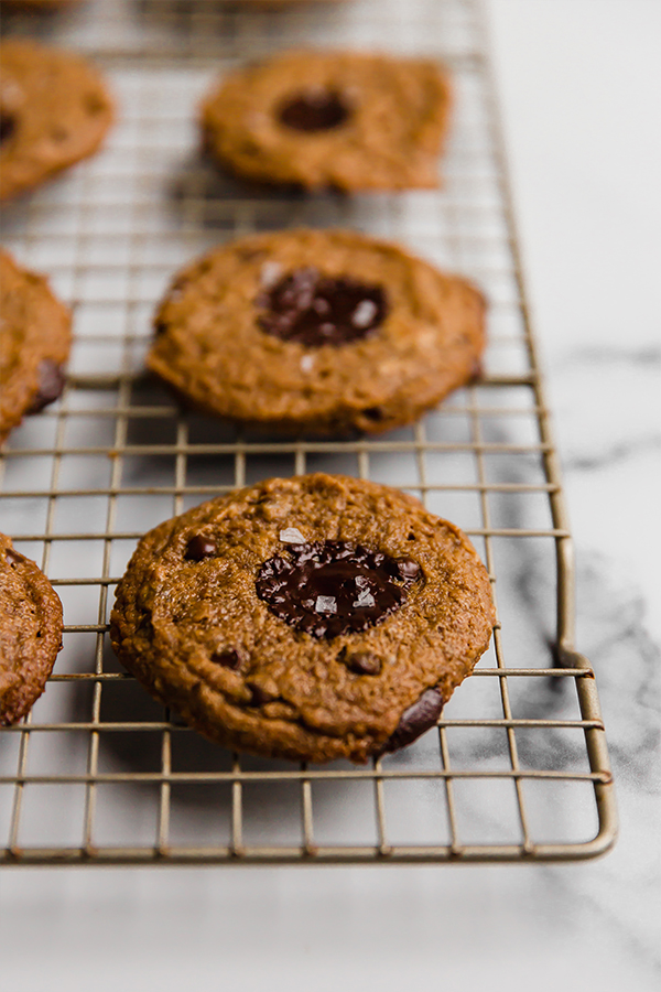 Up close image of baked flourless almond butter cookies on a cooling rack