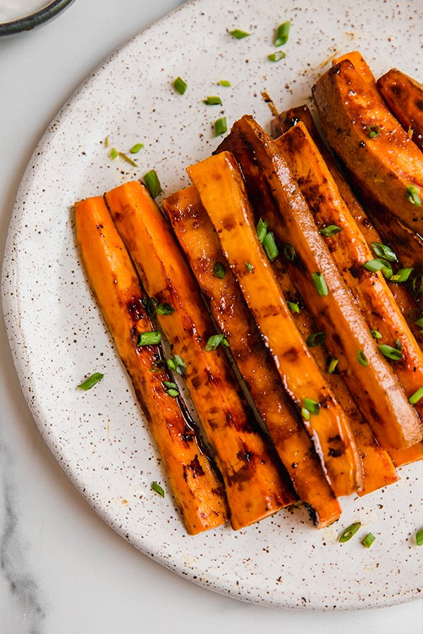 Sweet potato fries grilled and served on a plate