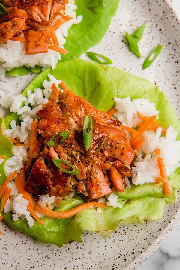 Top view of salmon lettuce cups on plate