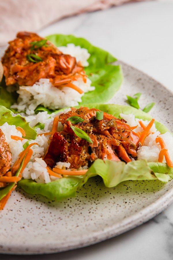Salmon lettuce wraps on a plate