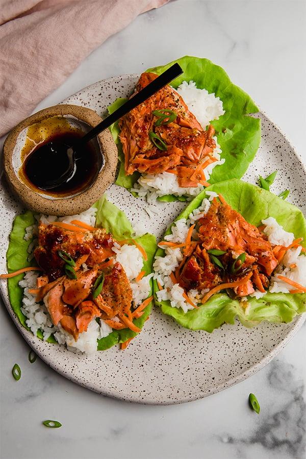 Salmon lettuce cups on plate with teriyaki sauce