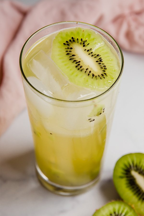 Kiwi refresher in a glass with ice