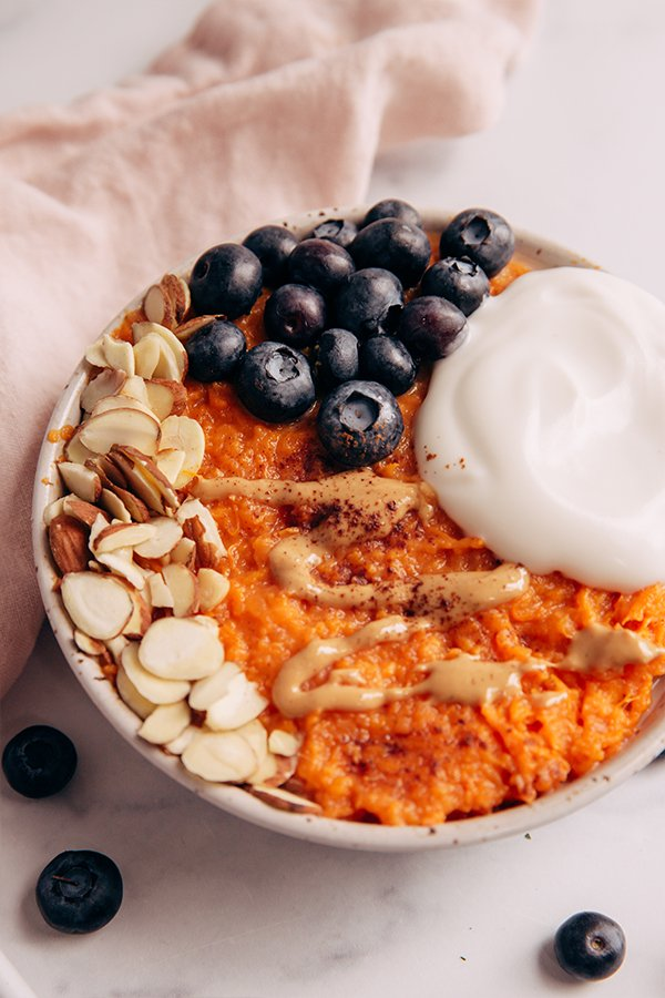 Sweet potato bowl with toppings on counter