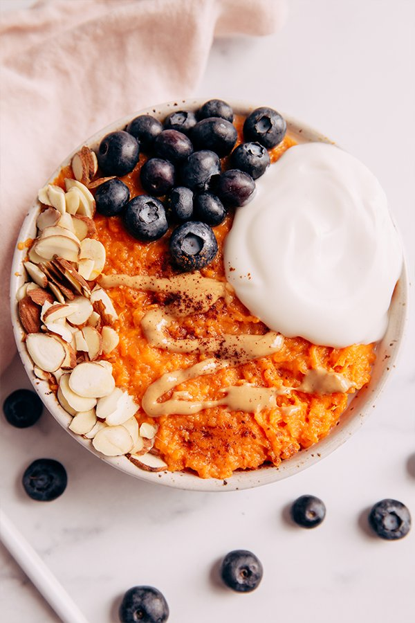 Top view of Sweet potato bowl with toppings on counter