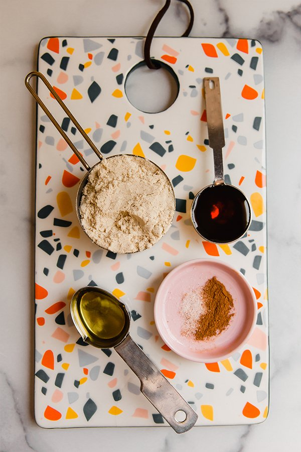 Ingredients for tigernut butter measured out on multicolored cutting board