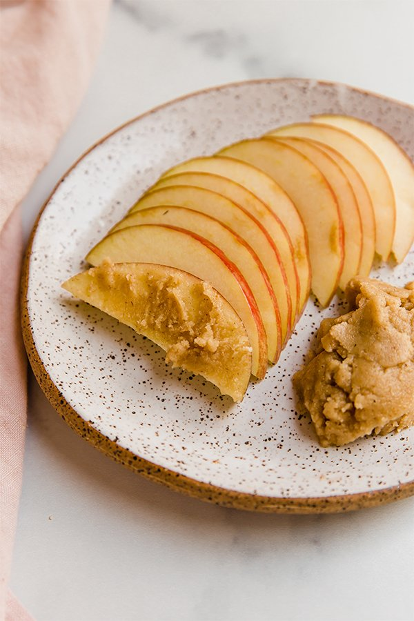 Apple slices on plate with tigernut butter