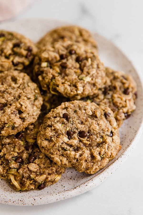 Oatmeal zucchini cookies stacked on a plate