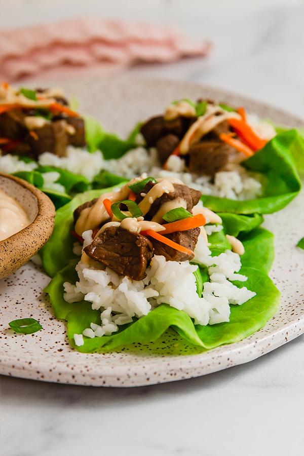 Hibachi steak lettuce wraps assembled on plate