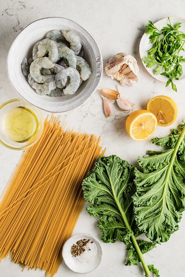 Ingredients for lemon garlic shrimp pasta on countertop