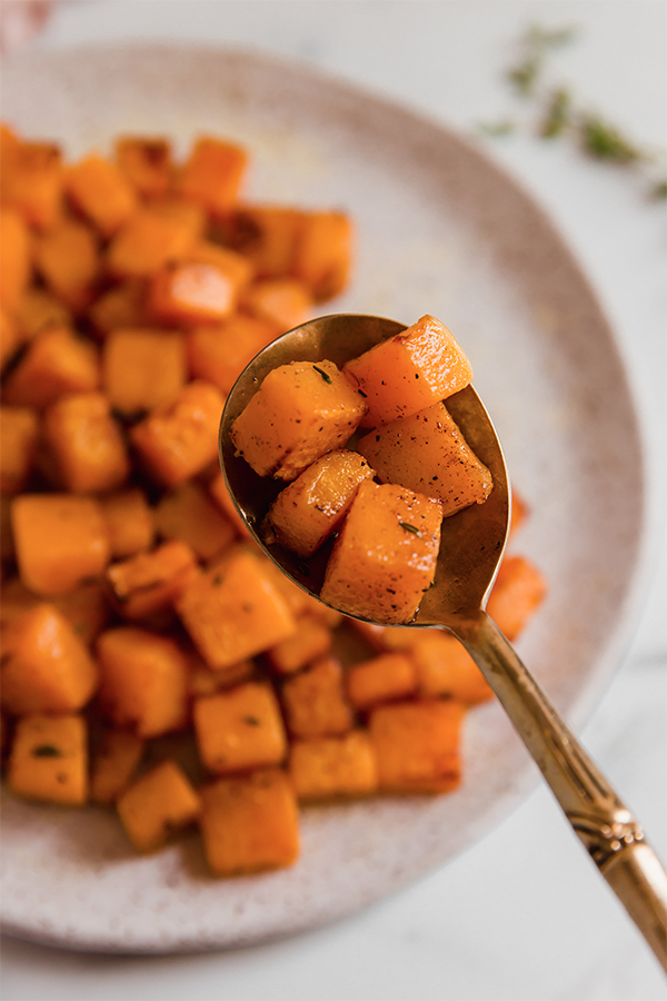 cubed butternut squash on a spoon